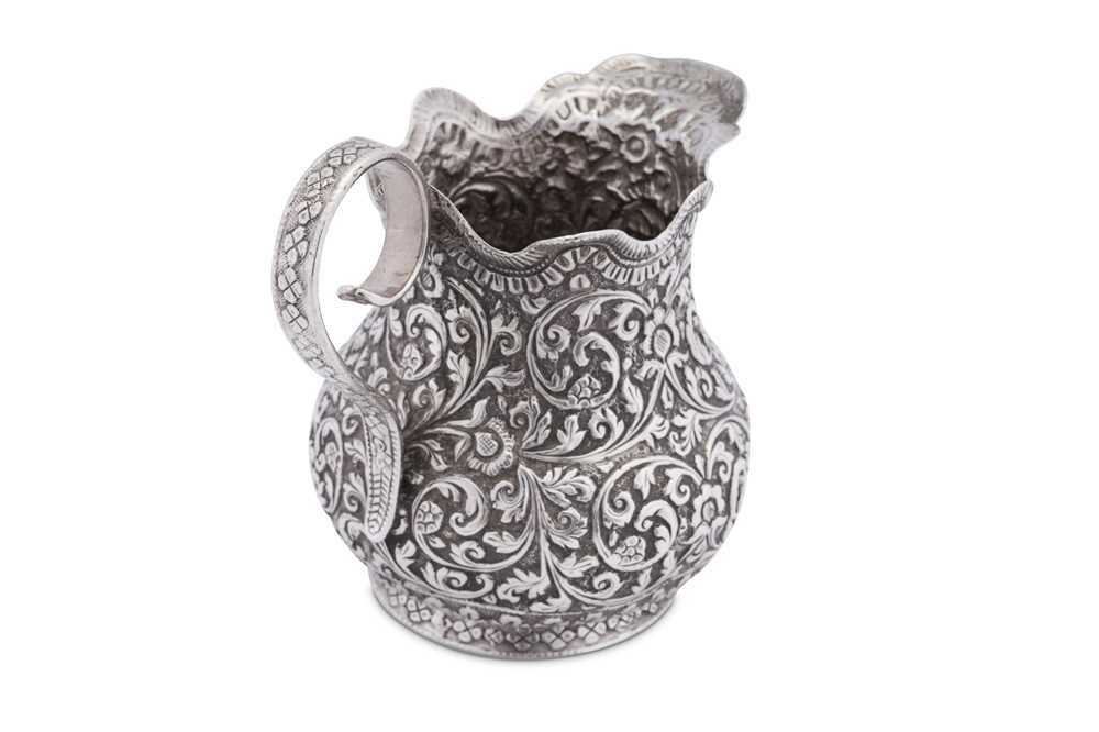 An early 20th century Anglo – Indian unmarked silver cream or milk jug, Cutch circa 1920 - Image 3 of 3