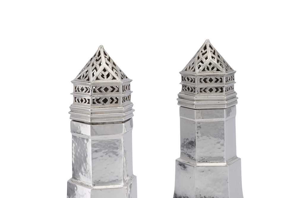 A pair of George V Arts and Crafts sterling silver sugar casters, London 1930/33 by Omar Ramsden (18 - Image 2 of 3
