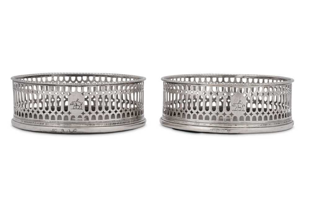 A pair of George III sterling silver wine coasters, London 1773 by I.W possibly for John Weldring (G