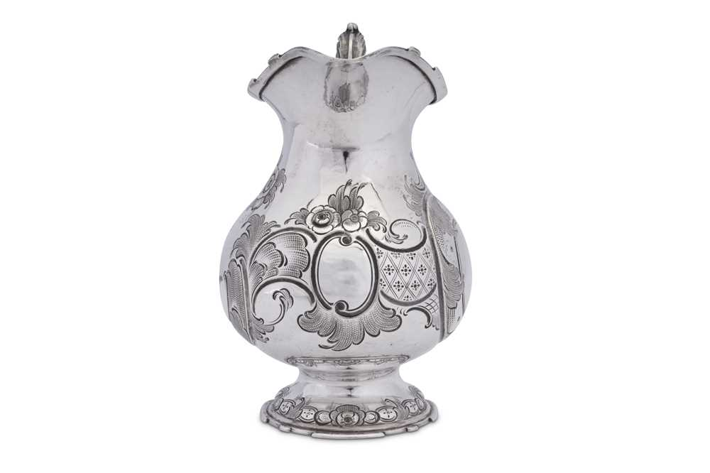 A mid to late 19th century German 13 loth (812 standard) silver jug or ewer, Munich circa 1870 by Ed - Image 2 of 4
