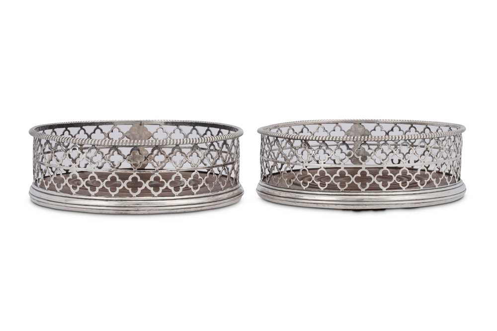 An unusual pair of George III sterling silver wine coasters, London 1768 by Thomas and William Chawn - Image 2 of 4