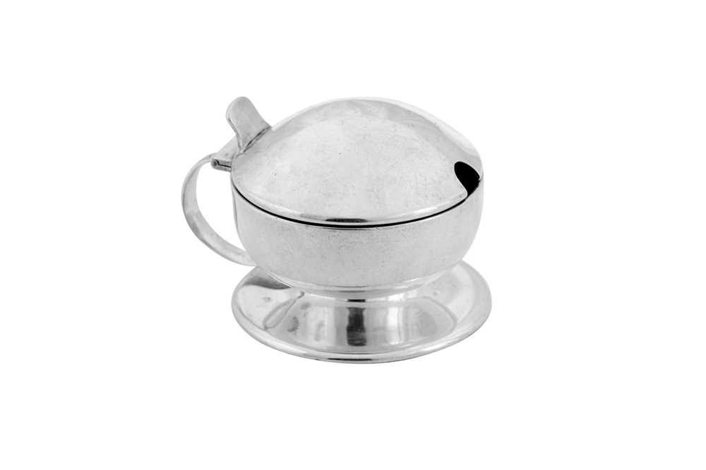 A George V 'arts and crafts' sterling silver mustard pot, Birmingham 1912 by Liberty and Co