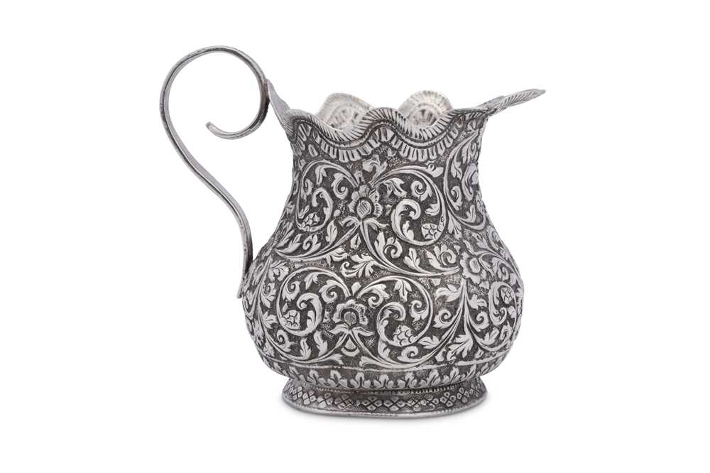An early 20th century Anglo – Indian unmarked silver cream or milk jug, Cutch circa 1920