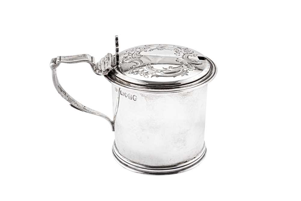 A Victorian sterling silver mustard pot, London 1865 by William Evans