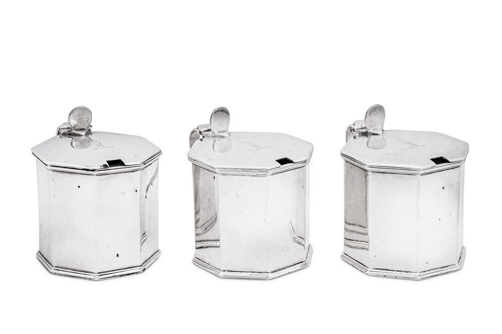 A set of three George V sterling silver mustard pots, London 1911 by Sebastian Garrard
