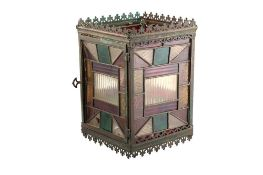 AN ARTS AND CRAFTS RECTANGULAR METAL AND STAINED GLASS HALL LANTERN