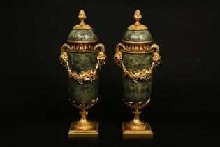 A PAIR OF LOUIS XVI STYLE GREEN MARBLE AND ORMOLU URNS AND COVERS