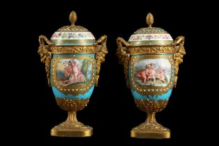 A PAIR OF 19TH CENTURY FRENCH SEVRES STYLE PORCELAIN AND ORMOLU MOUNTED URNS AND COVERS