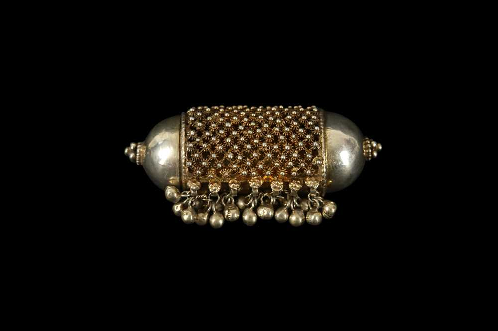 A 19TH CENTURY NORTH AFRICAN SILVER PRAYER SCROLL AMULET
