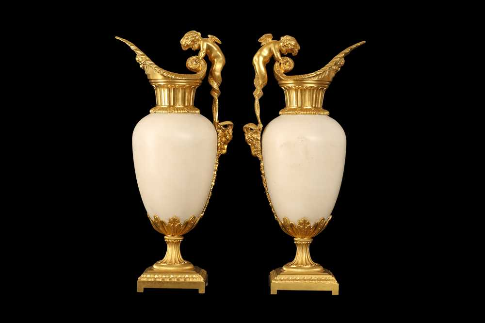 A FINE PAIR OF 19TH CENTURY FRENCH CARRARA MARBLE AND ORMOLU EWERS