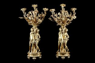 A LARGE PAIR OF 19TH CENTURY FRENCH GILT BRONZE FIGURAL CANDELABRA AFTER THE MODEL BY ETIENNE-MAURIC