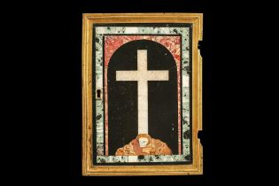 A 17TH CENTURY PIETRE DURE PANEL OF A CROSS WITH SKULL SET IN A TABERNACLE DOOR