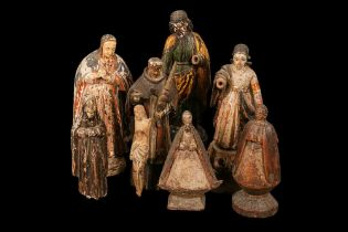 AN 18TH CENTURY PORTUGUESE COLONIAL FIGURE OF THE VIRGIN TOGETHER WITH SEVEN FURTHER FIGURES