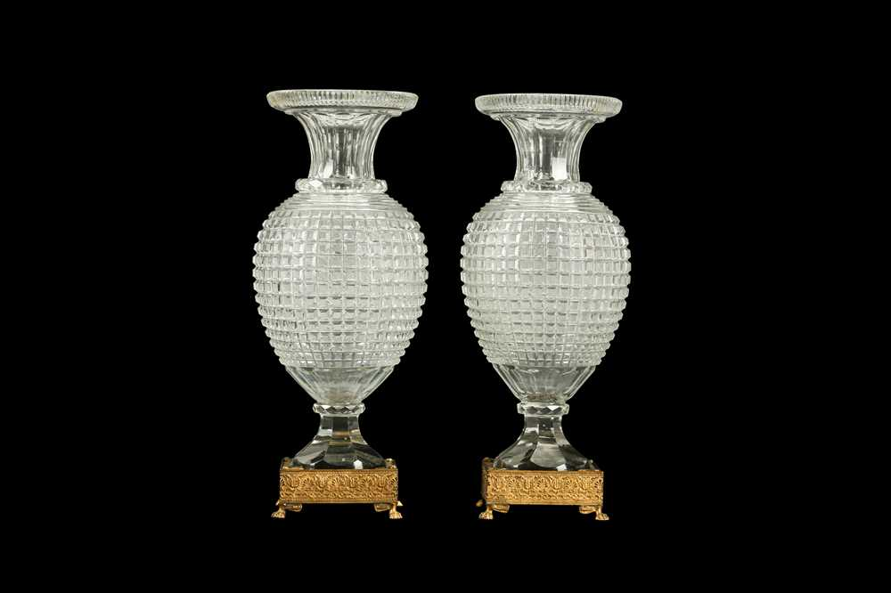 A PAIR OF EARLY 20TH CENTURY ORMOLU AND CUT GLASS VASES, POSSIBLY BACCARAT