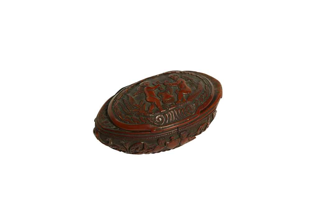 A RARE 18TH CENTURY COQUILLA NUT SNUFF BOX CARVED WITH A BEAST