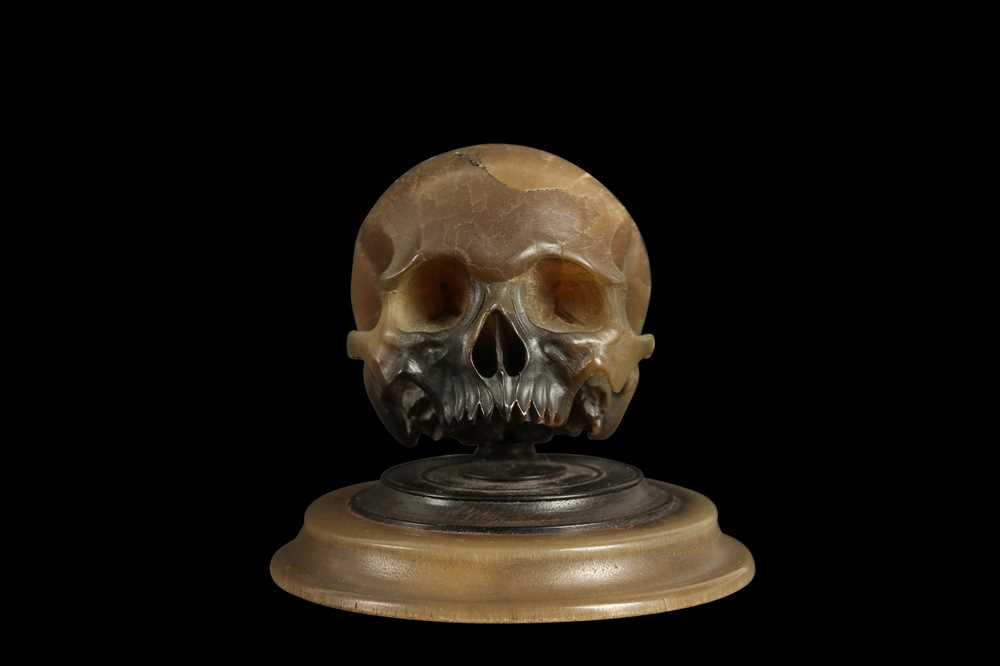 A RARE 17TH CENTURY GERMAN RHINOCEROS HORN MODEL OF A HUMAN SKULL