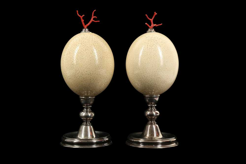 A PAIR OF MID-CENTURY OSTRICH EGGS MOUNTED WITH MEDITERRANEAN CORAL