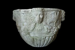 A 15TH / 16TH CENTURY ITALIAN CARVED MARBLE VESSEL DECORATED WITH LION MASKS AND BIRDS