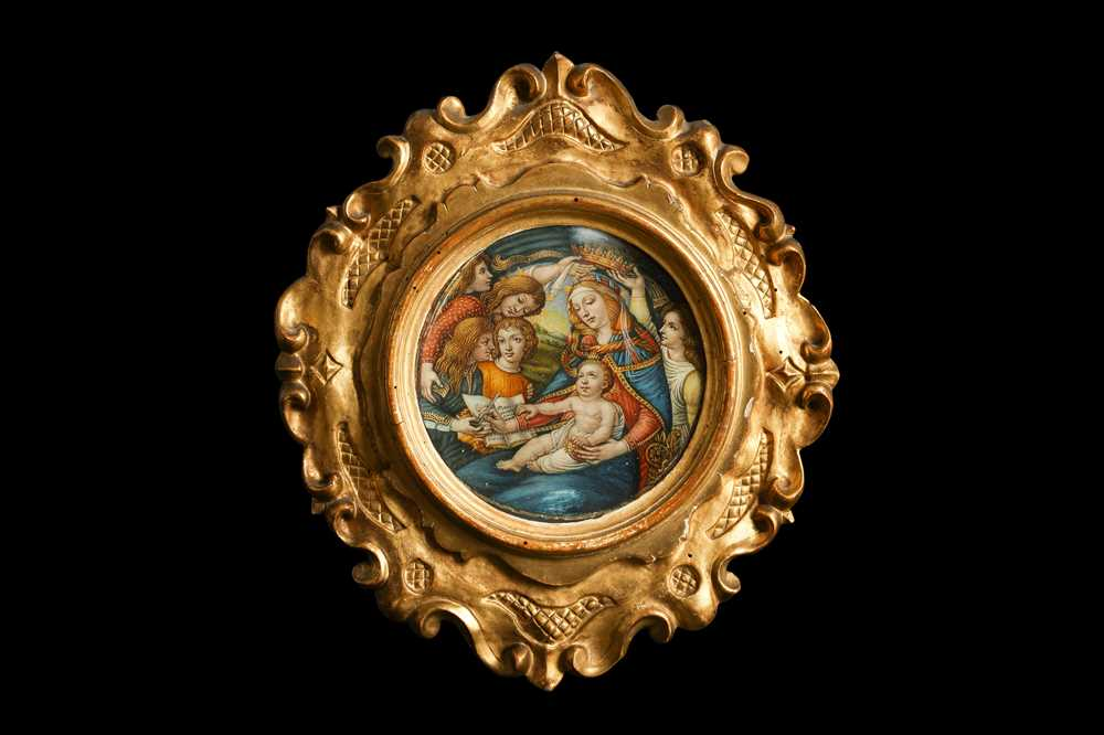 A 19TH CENTURY PAINTED IVORY PANEL DEPICTING THE MADONNA OF THE MAGNIFICAT, AFTER BOTTICELLI