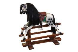 A DAPPLE GREY PAINTED WOOD ROCKING HORSE