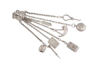 A Victorian unmarked silver chatelaine, with a vinaigrette, London 1848 by George Unite
