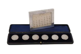 A CASED EARLY 20TH CENTURY SET OF SIX SILVER BUTTONS, BIRMINGHAM CIRCA 1902 BY REYNOLDS & WESTWOOD