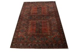 A MACHINE MADE RUG OF CLASSIC YOMUT DESIGN