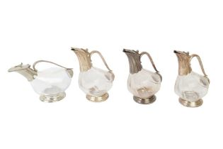 A SET OF THREE ZWIESEL SILVER PLATED AND GLASS DECANTERS