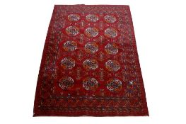 TWO RUGS, INCLUDING A BOKHARA RUG