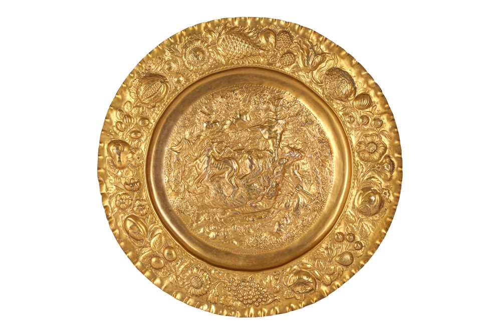 A MID 19TH CENTURY GILT METAL REPOUSSE DISH DEPICTING A BEAR HUNT, PROBABLY RUSSIAN