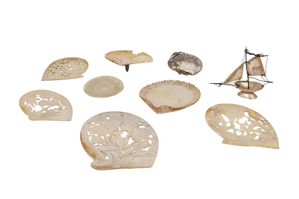 A COLLECTION OF NINE VARIOUS CARVED OYSTER / PEARL SHELLS OF VARIOUS DESIGN