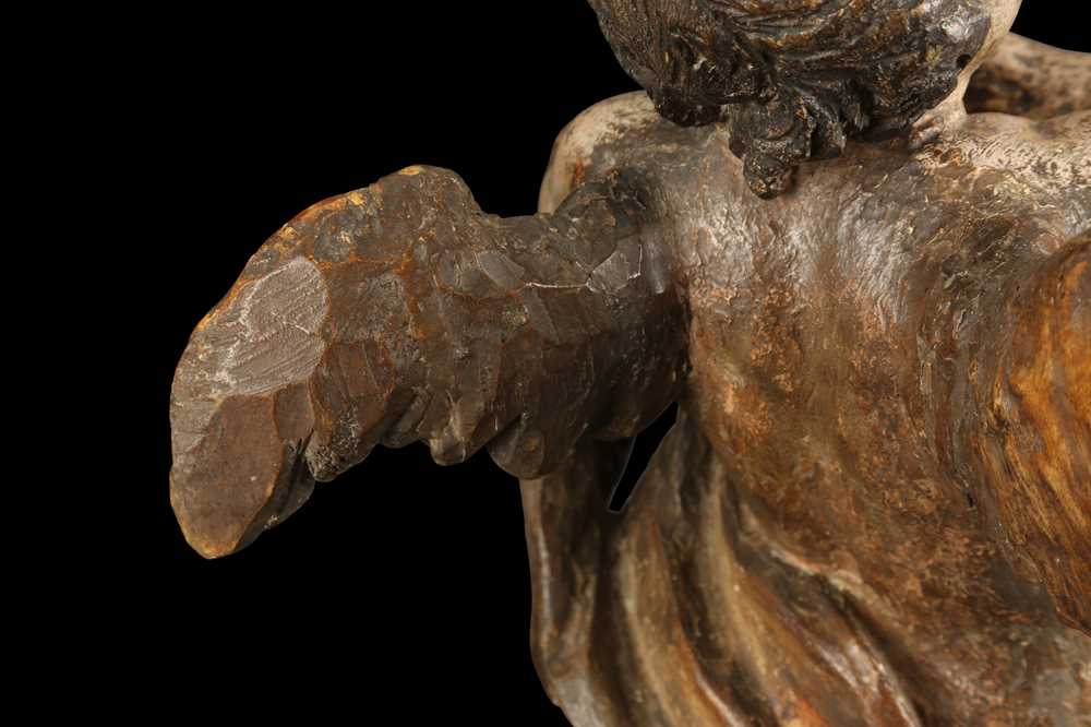 AN EARLY 17TH CENTURY SOUTH GERMAN POLYCHROME DECORATED AND CARVED WOOD FIGURE OF A CHERUB - Image 3 of 7