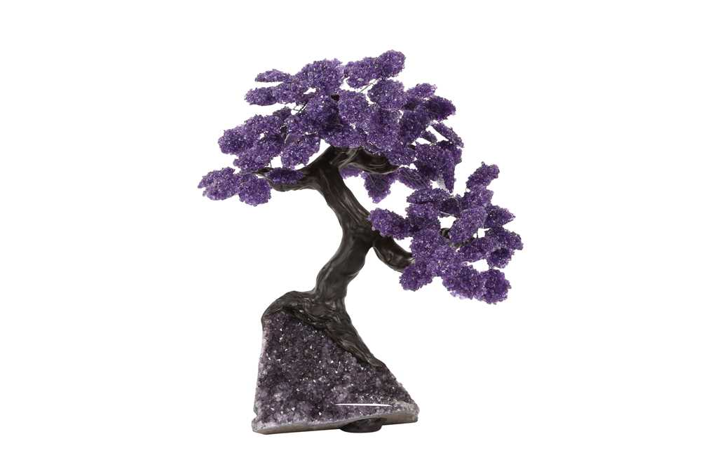 AN AMETHYST GEODE AND AMETHYST CHIP MODEL OF A TREE IN BLOSSOM