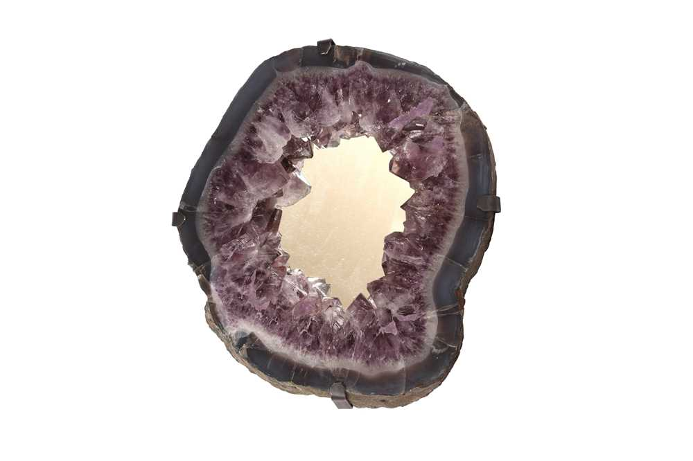 A WALL MIRROR FORMED FROM AN AMETHYST GEODE, SOUTHERN BRAZIL