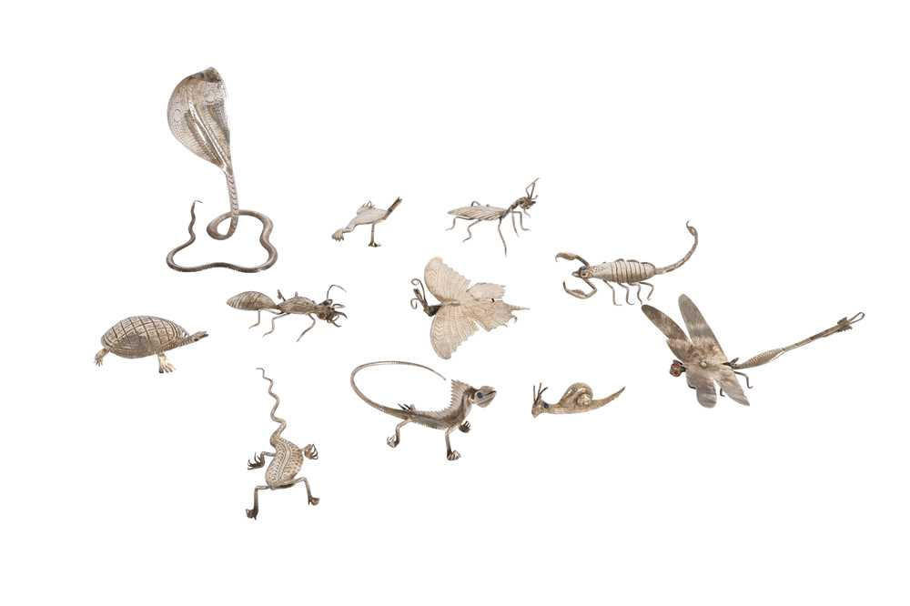 A COLLECTION OF ELEVEN WHITE METAL INDIAN MINIATURE CREATURES
