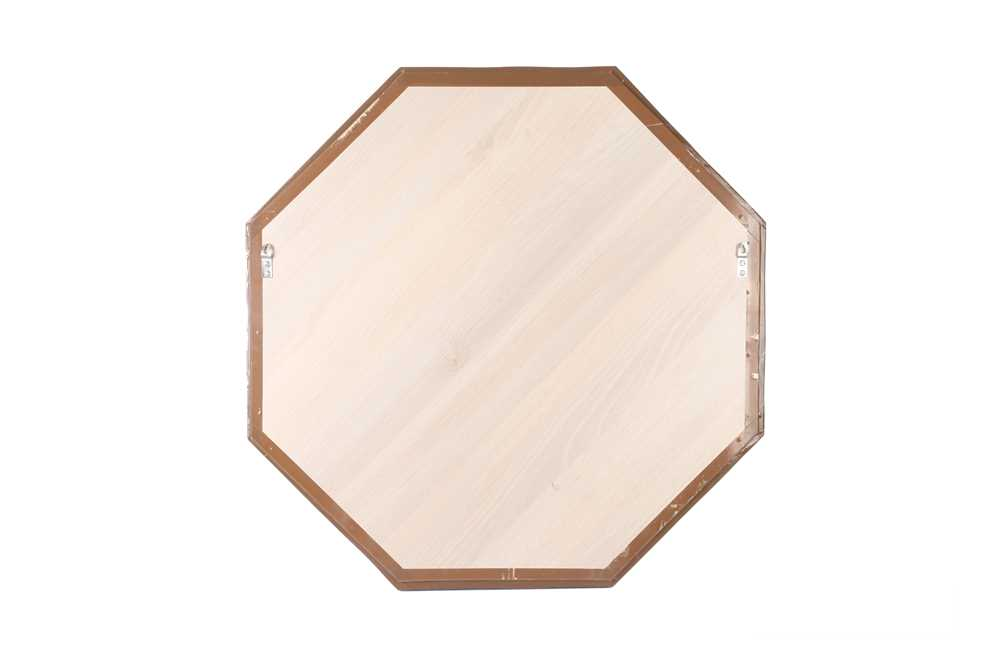 AN OCTAGONAL LAPIS LAZULI VENEERED WALL MIRROR - Image 2 of 2