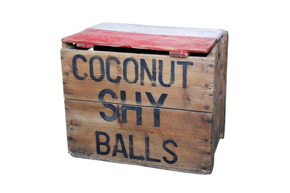 A BOX OF NINE ORIGINAL FAIRGROUND COCONUT SHY BALLS