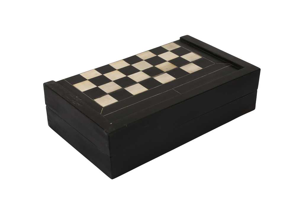 A 17TH CENTURY NORTH ITALIAN EBONY AND IVORY GAMING BOARD FOR CHESS AND BACKGAMMON
