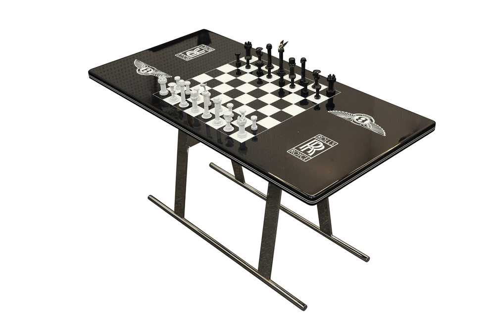 A ROLLS ROYCE AND BENTLEY THEMED CHESS TABLE