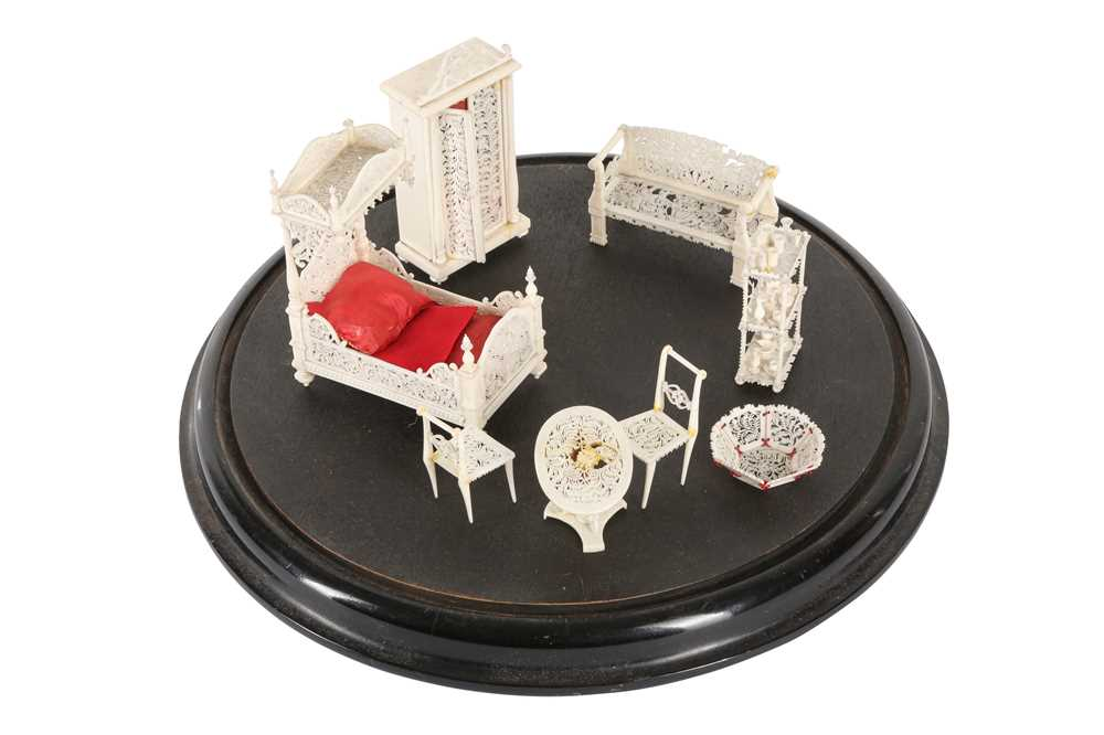 A 19TH CENTURY CARVED BONE SET OF MINIATURE FURNITURE WITHIN A GLASS DOME - Image 3 of 3