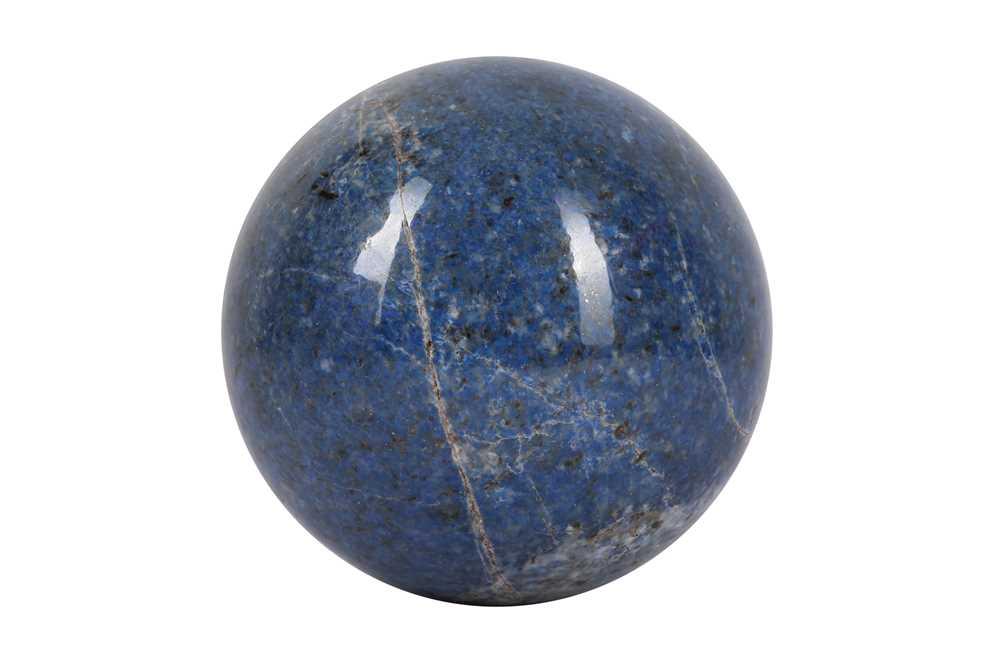 A SOLID 'BLUE JEAN' LAPIS LAZULI SPHERE