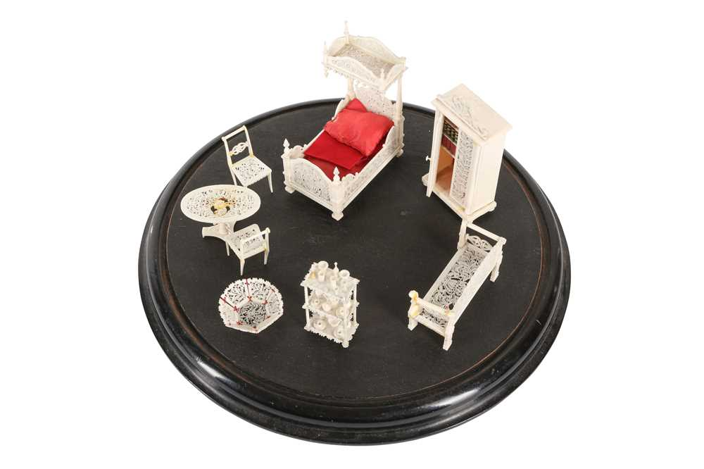 A 19TH CENTURY CARVED BONE SET OF MINIATURE FURNITURE WITHIN A GLASS DOME - Image 2 of 3