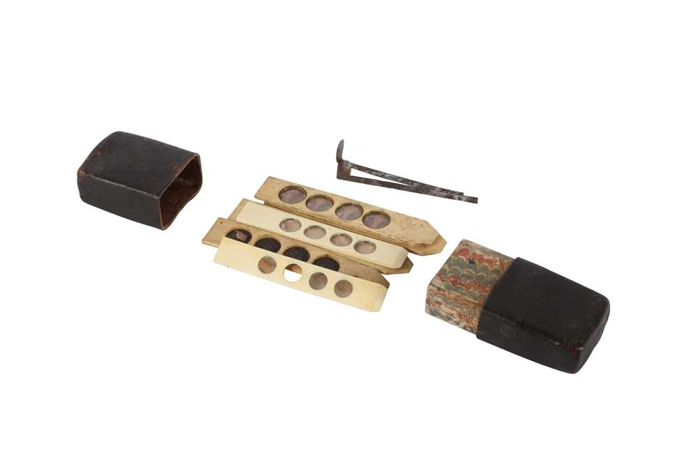 A CASED SET OF EARLY 20TH CENTURY BONE AND IVORY MICROSCROPE SLIDES