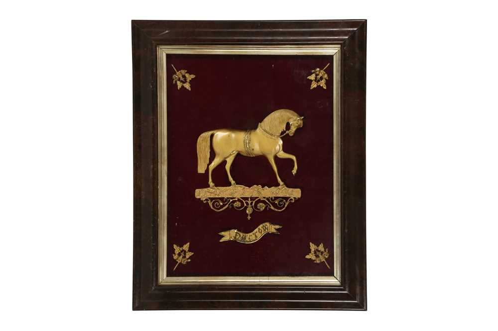 A 19TH CENTURY GILT METAL RELIEF DEPICTING A HORSE