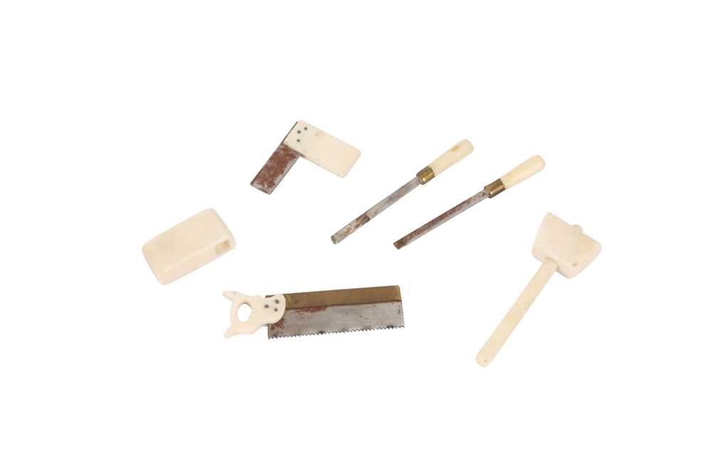 A SET OF LATE 19TH CENTURY MINIATURE IVORY TOOLS