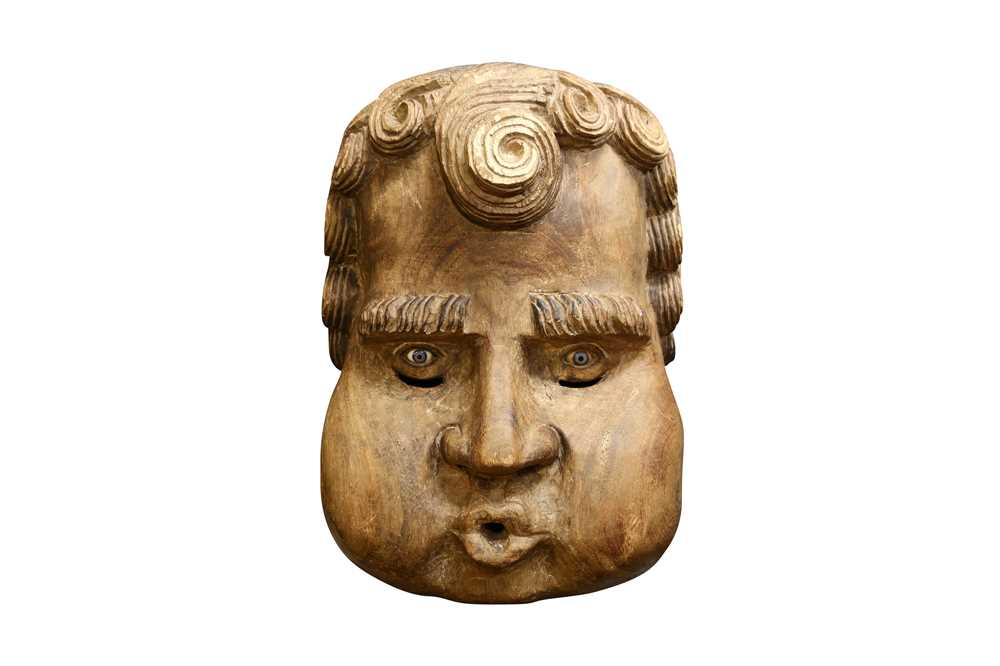 AN UNUSUAL AND LARGE LATE 19TH OR EARLY 20TH CENTURY CARVED WOOD HEAD OF A CHILD