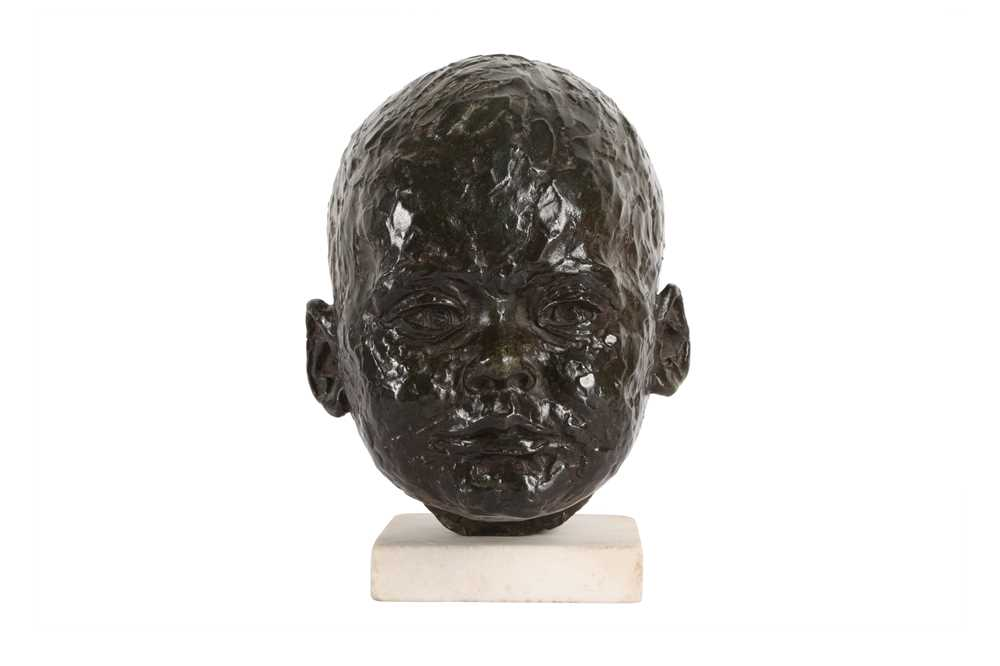 A BRONZE HEAD OF A BABY IN THE MANNER OF SIR JACOB EPSTEIN (BRITISH, 1880-1959)