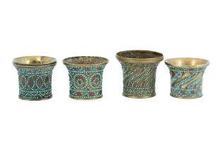 FOUR GLASS BEAD AND TURQUOISE-SET BRASS QALYAN CUPS Qajar Iran, 19th century