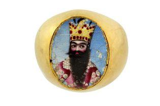 A GOLD RING WITH A POLYCHROME-PAINTED ENAMEL PORTRAIT OF FATH 'ALI SHAH (R.1797 - 1834) Qajar Iran,
