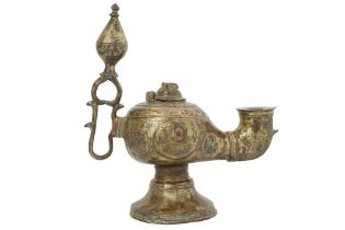 A KHORASAN-REVIVAL COPPER-INLAID BRASS OIL LAMP Possibly Khorasan, North-Eastern Iran, 19th century